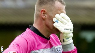 Dundee goalkeeper Rab Douglas shows his disappointment at Tannadice