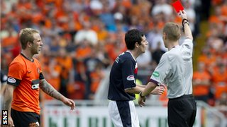 Murray shows O'Donnell the red card after sending off Russell