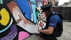 A PCSO contributing to the artwork