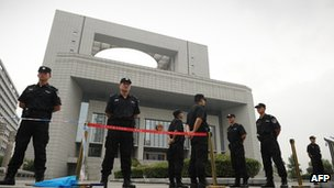 Police outside the court in Hefei on 10 August