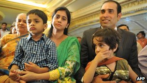 Indian cricketer Vangipurappu Venkata Sai (VVS) Laxman (R), wife Sailaja amd their children Sarvajith and Achinthya attend a press conference held to announce his retirement from Test Cricket at the Rajiv Gandhi International cricket stadium in Hyderabad on August 18, 2012.