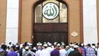 Muslims queuing to enter a mosque for Eid prayers