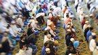 Men take part in Eid al-Fitr prayers