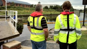 Environment Agency staff helping to clear diesel from the River Aire