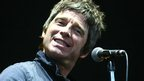Noel Gallagher smiles at the crowd on the Virgin Media Stage in Hylands Park