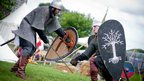 The Fellowship of the Green Dragon practicing sword fighting at the Return of the Ring.