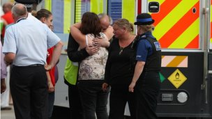 Family members being comforted at Burnham-on-Sea