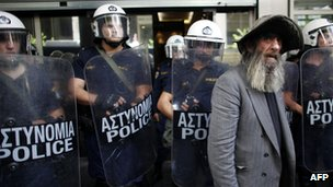 Greek elderly man with riot police