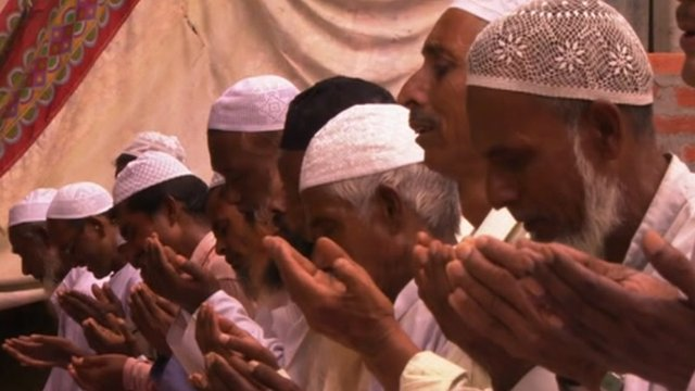 Muslims reciting prayers