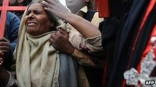 A Pakistani Christian grieves after Mr Bhatti, who called for a reform to the laws was shot dead