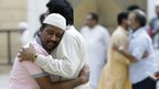 Residents hug each other as they celebrate Eid al-Fitr that marks the end of the holy fasting month of Ramadan after offering morning prayers outside the Imam Turki bin Abdullah mosque in Riyadh