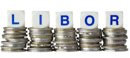 A set of dice spelling out the word LIBOR sat on top of a pile of coins.