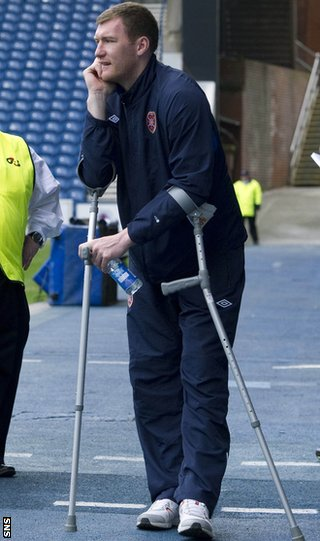 Kyle is forced to look on from the sidelines on crutches while with Hearts
