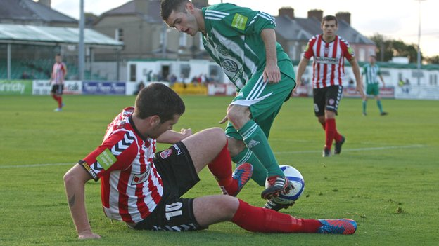 Pat McEleney tackles Bray striker Kieran Waters