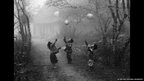 H'Mong children playing with balloons on a foggy day in Moc Chau, Ha Giang province, Vietnam