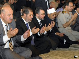 Gen Abdul Fattah al-Sisi (far right) prays in Cairo, alongside President Mohammed Mursi (second-left)