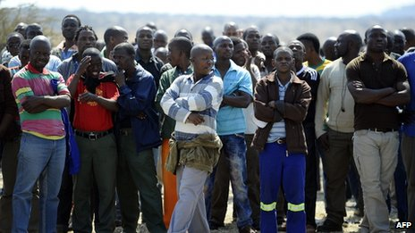 Striking platinum miners gather on 20 August 2012 at Lonmin's Marikana platinum mine