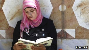 A girl reads the Koran