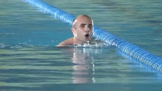 An athlete trains at a swimming pool in the Georgian capital  