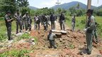 Thai security personnel inspect the site of a bomb attack