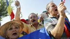 Protesters shout anti-presidential slogans during a rally in front of Romania's Constitutional Court in Bucharest.