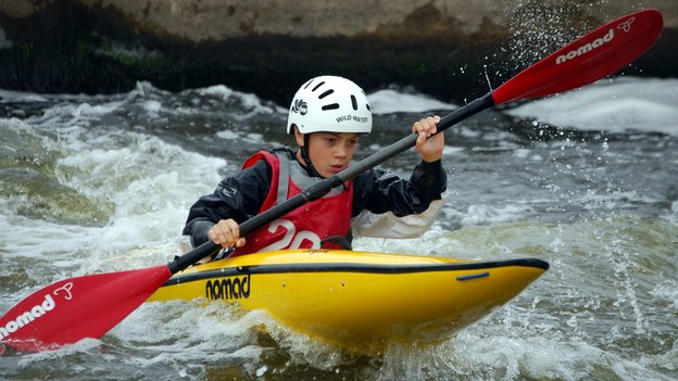 Louis going down a canoe slalom course