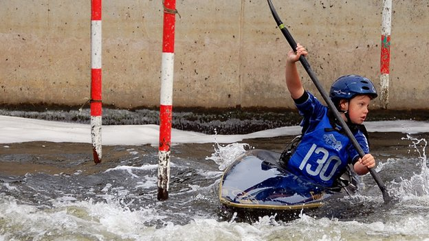 Zak going down a canoe slalom course