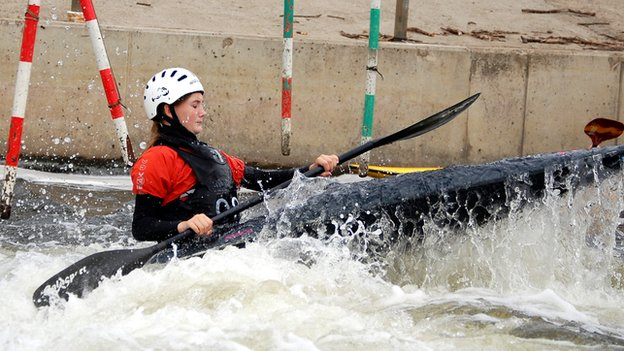 Jess hitting white water on a canoe slalom course