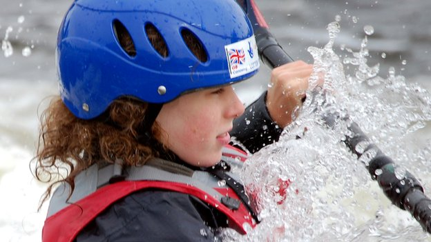 Daniel going down a canoe slalom course