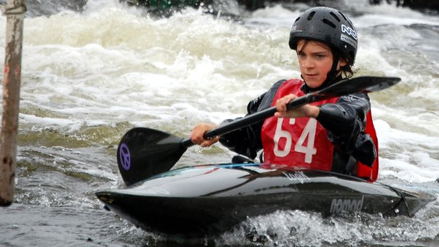Jacob paddling down a canoe slalom course