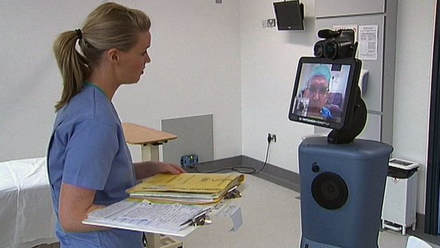 Nurse speaks with robot doctor