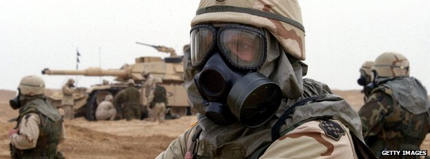 US soldiers in biochemical warfare suits