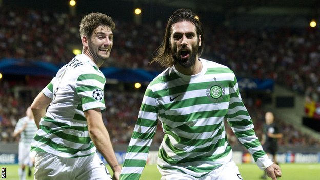 Charlie Mulgrew rushes to congratulate Celtic goalscorer Georgios Samaras