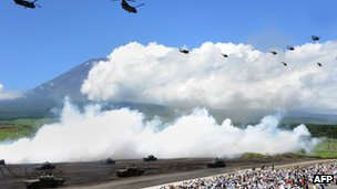 Tanks and helicopters from Japan's Ground Self-Defence Forces join in a military exercise at the Higashi-Fuji firing range in Gotemba, at the foot of Fuji Mountain in Japan, 21 Aug 2012
