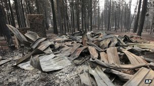 The burned remains of a home destroyed by a Ponderosa fire are seen near Manton, California, on Monday