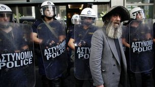 Greek pensioner with police