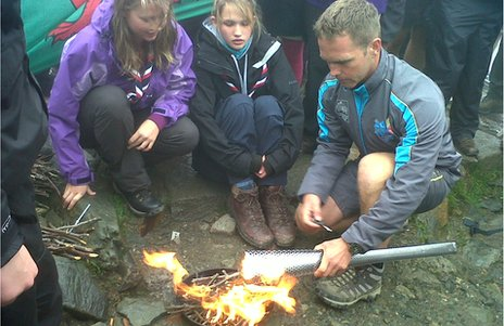 Scouts ignited the flame on the top of Snowdon which was then used to light the torch