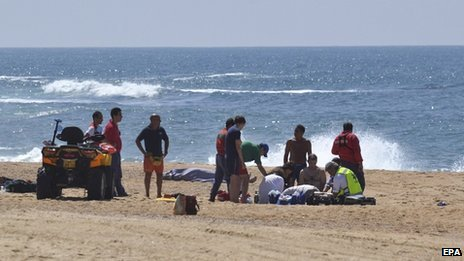 The scene at Salgado Beach in Nazare, Portugal on 21 August