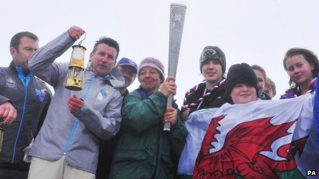 LOCOG chairman Lord Coe with the Scouts on the summit of Snowdon