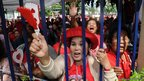 "Thai ""Red Shirts"" supporters shout slogans as they gather outside the Criminal Court in Bangkok."