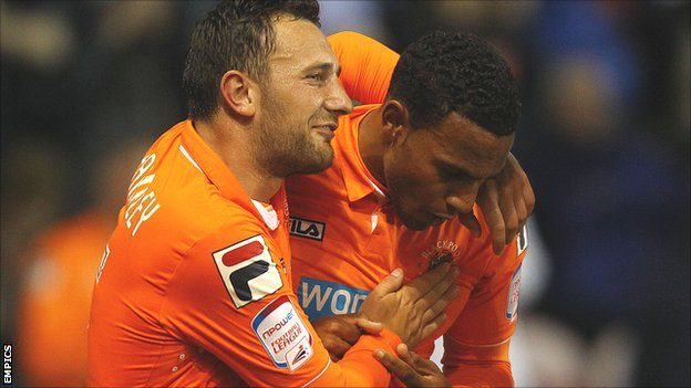 Blackpool's Neal Eardley (l) celebrates with Matt Phillips after the winger's winning goal against Leeds on Tuesday