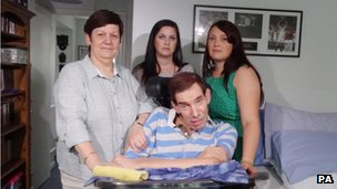 Tony Nicklinson with his wife Jane (left) and daughters Beth (right) and Lauren at home in Melksham