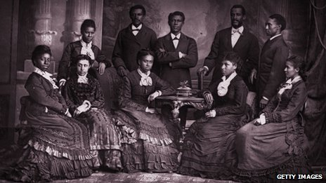 The Jubilee Singers of Fisk University on a visit to England where they where invited to give a concert before Queen Victoria (front row from left to right: Jennie Jackson, Mabel Lewis, Ella Sheppard, Maggie Carnes, America W Robinson; back row left to right: Maggie Porter, E W Watkins, H D Alexander, F J Loudin and Thomas Rutling)