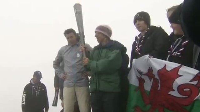 Lord Coe with the Paralympic torch on Snowdon