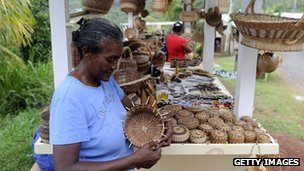 A Carib tribeswoman at her handicraft stand beside the main road in the Carib village, Dominica