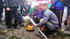 Paralympic torch being lit at the top of Mount Snowdon