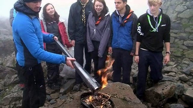 Scouts gather as the Paralympic torch is lit at the summit of Ben Nevis