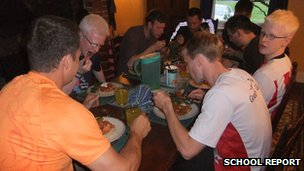 The goalball squad eating together at the family's dinner table