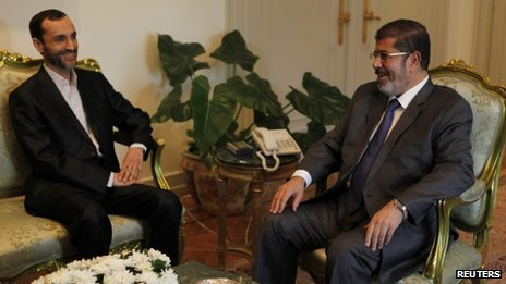 Egypt's President Mohammed Morsi (right) meets Iran's Executive Vice President Hamid Baghai at the presidential palace in Cairo, August 8, 2012