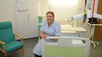 Staff nurse Jo Anyon sat on a mock-up of a single room